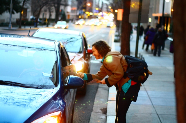 A DC Bike Ambassador passing out bike lane driving guidelines. Photo by Matt Kroneberger.